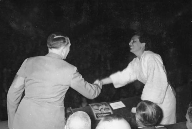 """Adolf Hitler and Leni Riefenstahl , 1938. Photo via <a href=""""http://commons.wikimedia.org/wiki/Category:Leni_Riefenstahl#mediaviewer/File:Bundesarchiv_Bild_146-1968-036-06,_Leni_Riefenstahl_und_Adolf_Hitler.jpg"""">Wikimedia Commons</a>"""