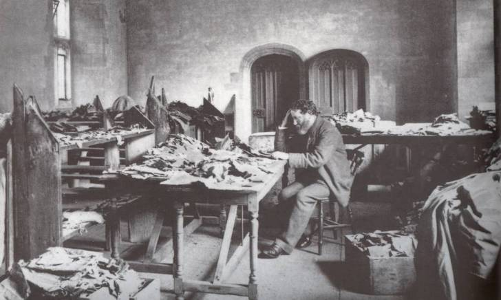 Solomon Schechter studying the fragments from the Cairo Geniza, Photo via Cambridge University Library.