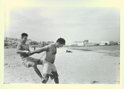 Jack Kerouac and Peter Orlovsky horsing around on the beach in Tangier, 1957. Photo by Allen Ginsberg, courtesy of Thomas Fisher Rare Book Library