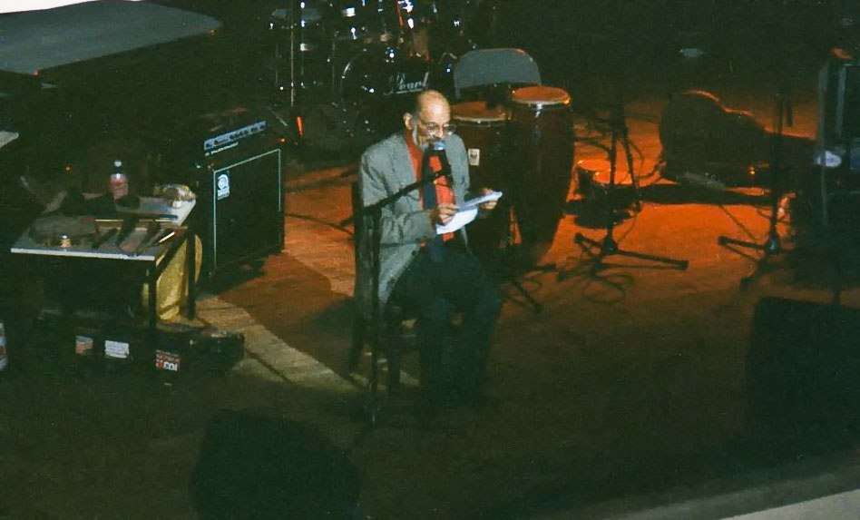 Allen Ginsberg reading at NYU, 1995. Photo by Frank Beacham