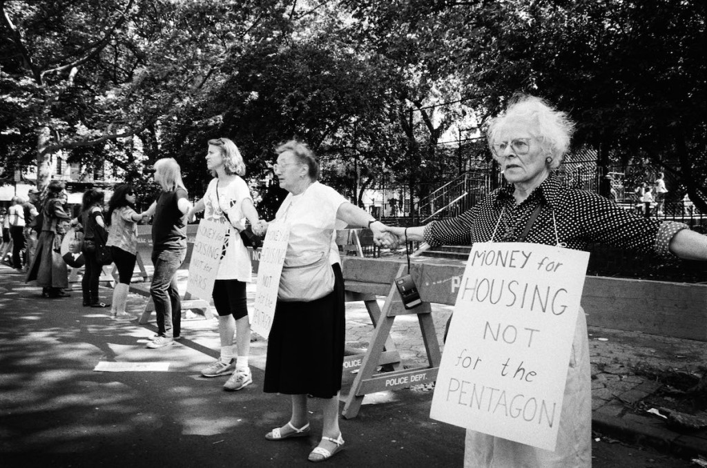 Surrounding Tompkins Square Park, Lower East Side residents show solidarity in hands in hands to protest the forceful Tompkins Square Park closure. June 1991.