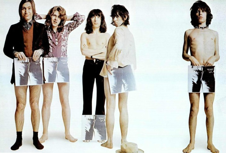 The Rolling Stones posing in an ad with the artwork from Sticky Fingers. Photo byWikimedia Commons