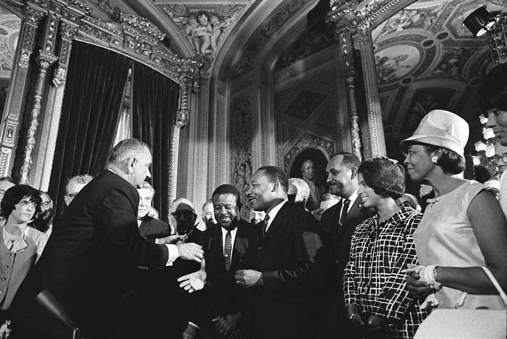 President Lyndon B. Johnson, Martin Luther King, Jr., and Rosa Parks at the signing of the Voting Rights Act on August 6, 1965. Photo:Wikimedia Commons
