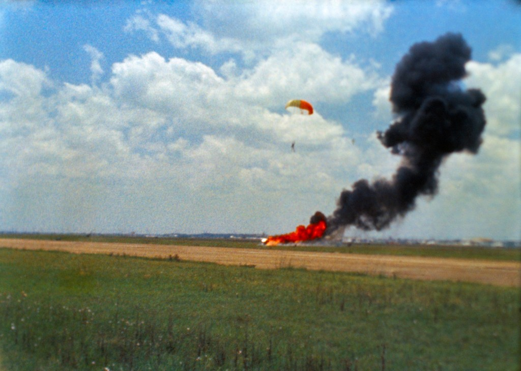 Neil Armstrong floats safely to the ground as Lunar Landing Research Vehicle (LLRV) no.1 crashes at Ellington Air Force Base 6 May 1968. // NASA // Wikimedia Commons