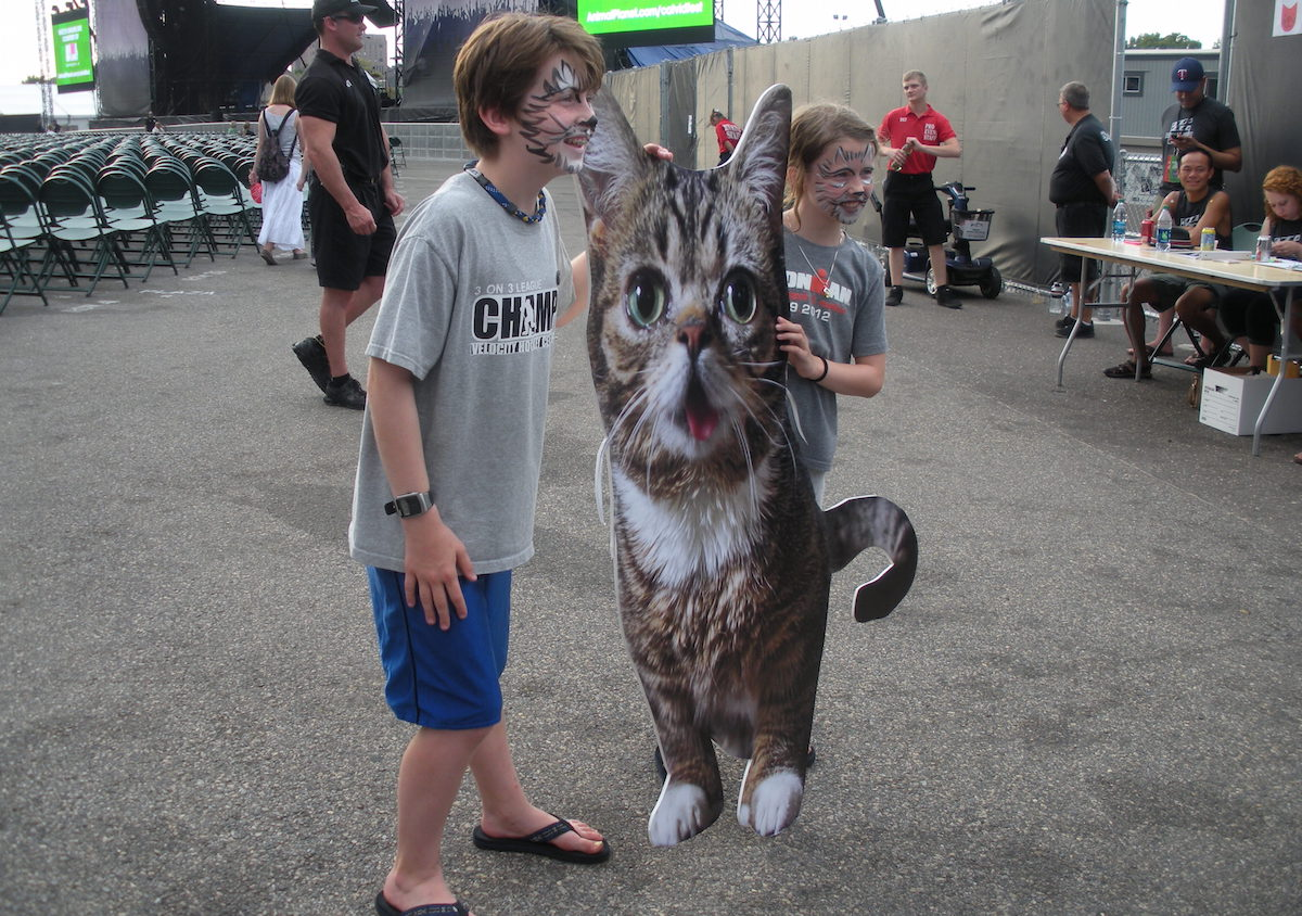 Photo: Children posing with life-size Lil Bub. This photo first appeared on Hyperallergic. Courtesy Jillian Steinhauer.