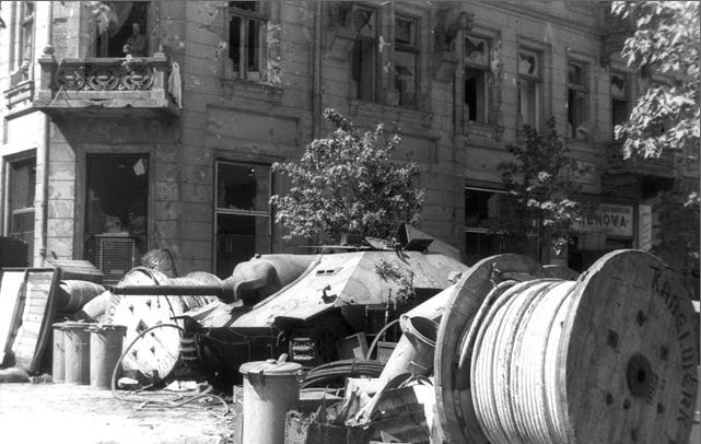 Barricade built around a captured German tank, August 1944. Via Wikimedia Commons.