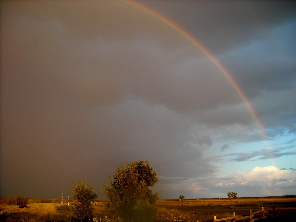 A rainbow appears over North Dakota's badlands.