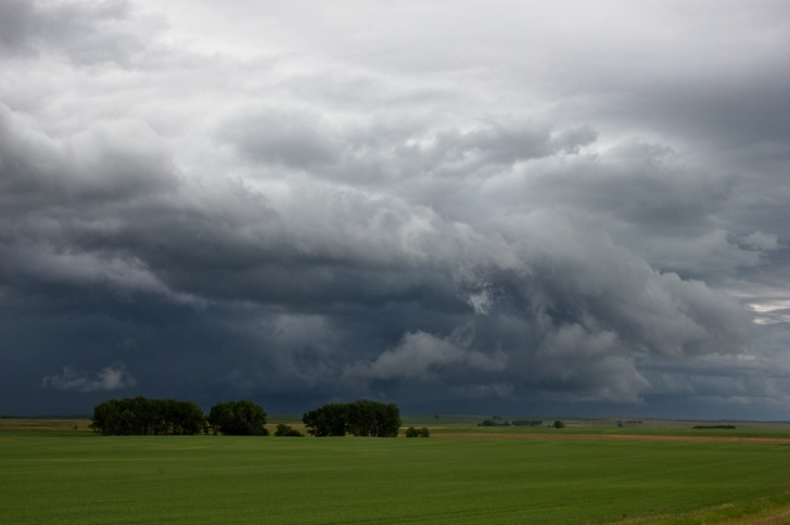 A storm approaches the plains near Adams, North Dakota.