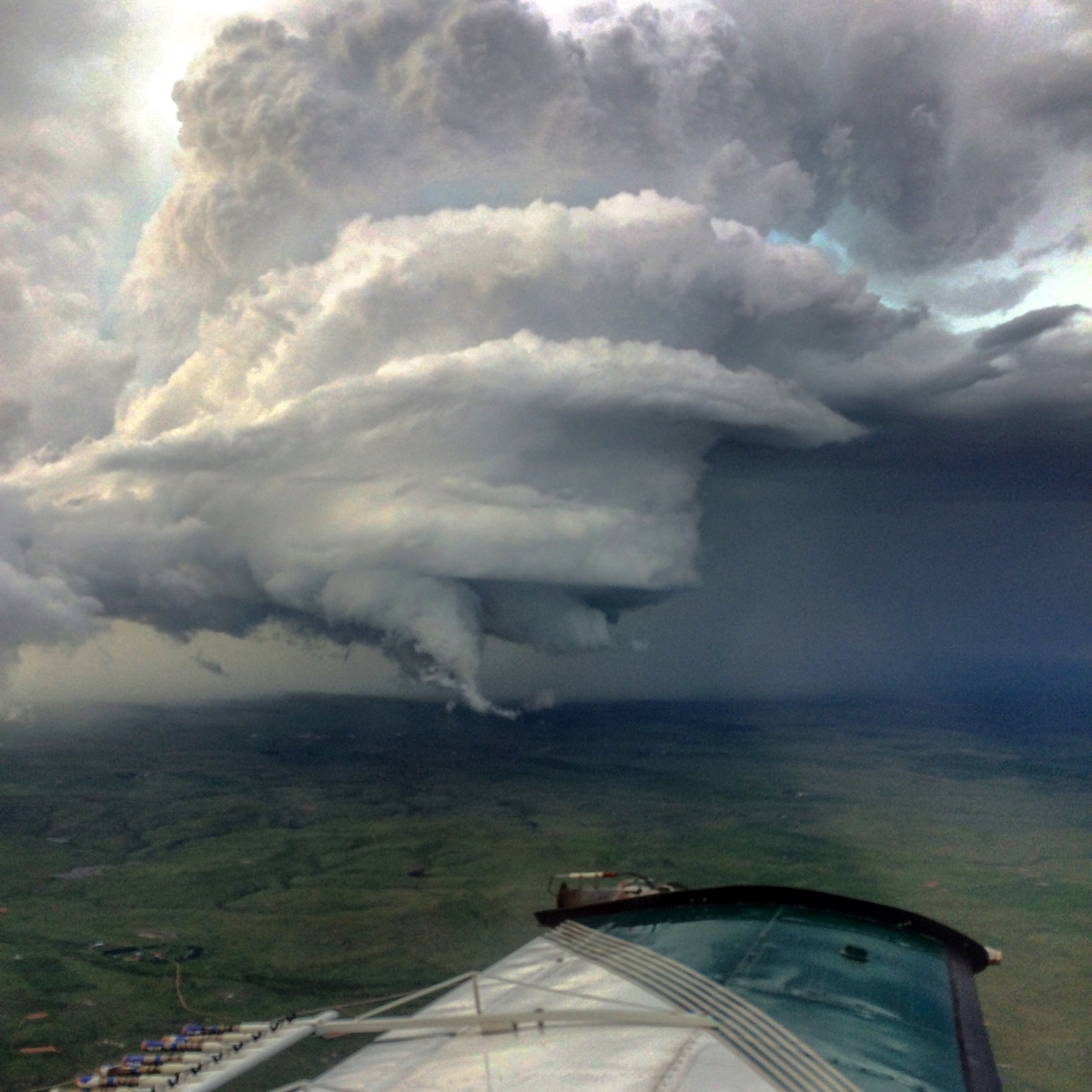 The view from Steffany Royal's Piper Seneca of a gathering singlecell thunderstorm.