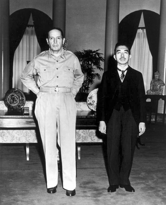 MacArthur and Hirohito. Via Wikimedia Commons.