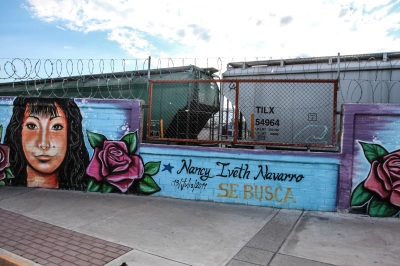 """Looking for Nancy Iveth Navarro, disappeared on July 13, 2011"" reads one of several murals of disappeared girls painted in front of the train station that runs through the heart of Juárez. Photo: Alice Driver"