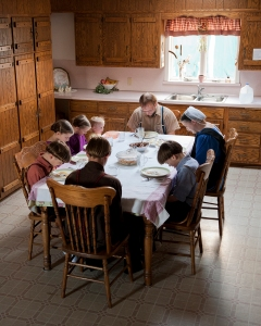 An Amish family praying together before dinner. Photo: Tessa Smucker