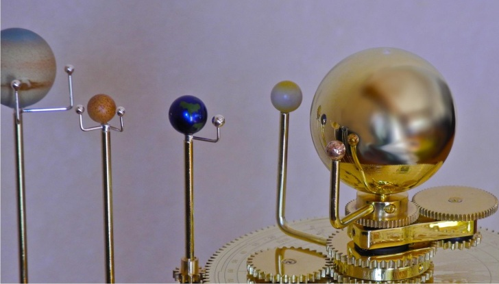 An orrery, or mechanical model of the solar system. Via Wikimedia Commons.