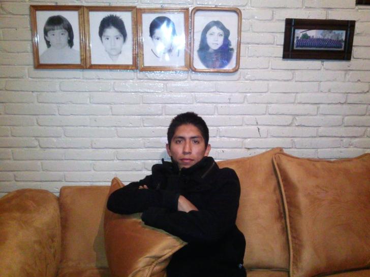 Juan in his mother's living room.