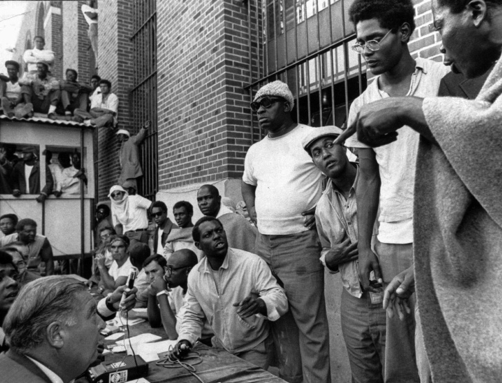 Inmates of the Attica Correctional Facility negotiating with Russell G. Oswald, lower left, the state prisons commissioner, in September 1971. ASSOCIATED PRESS