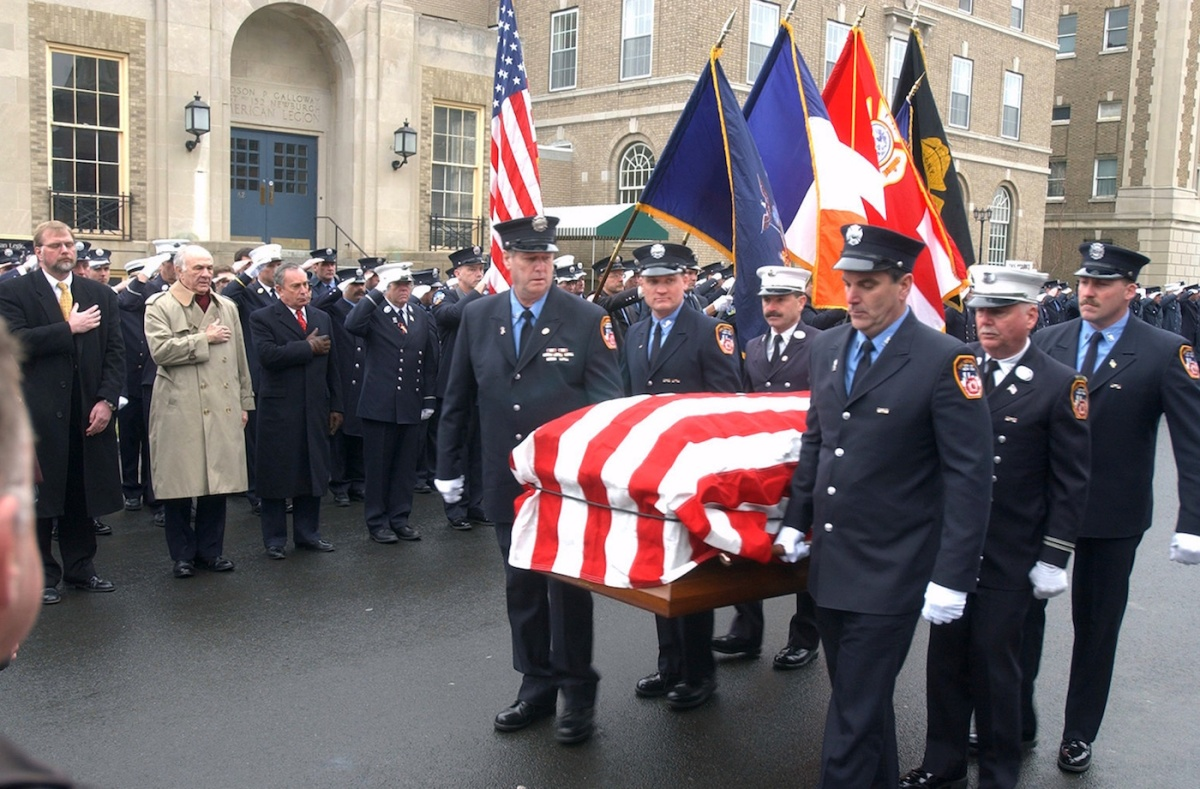 Fellow firefighters carry the flag-covered coffin of Paul Ruback outside St. Patrick's Church in Newburgh, N.Y. (Photo by Howard Earl Simmons/NY Daily News Archive via Getty Images)