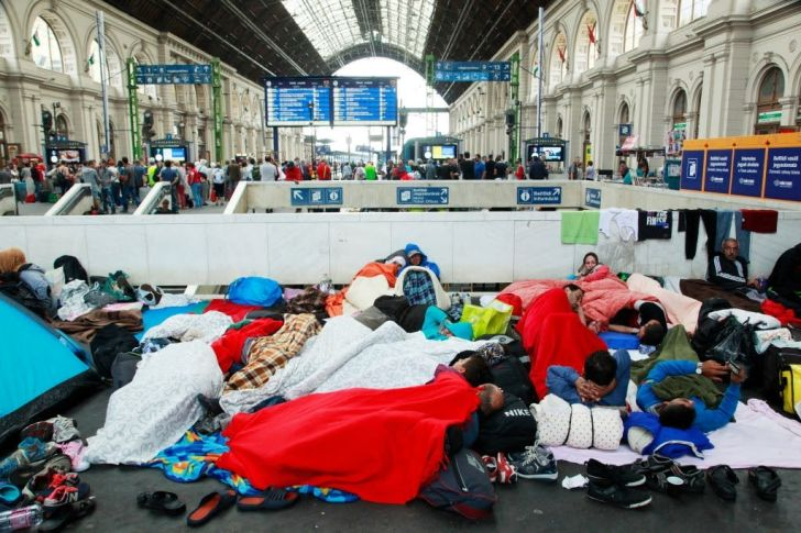 Refugees at Budapest Keleti railway station, September 2015. Via  Wikimedia Commons.