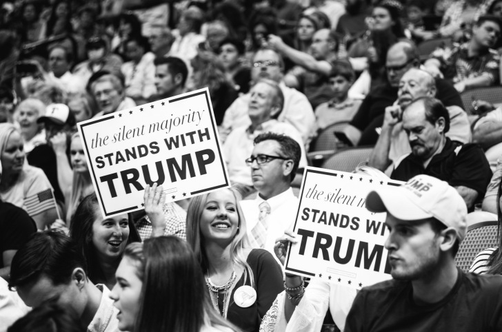 young women holding signs at a donald trump rally