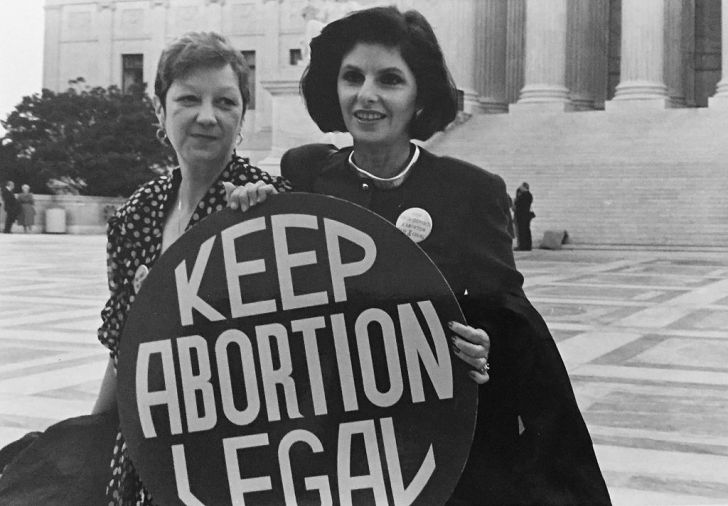 Norma McCorvey (Jane Roe) and her lawyer Gloria Allred on the steps of the Supreme Court, 1989. Photo by Lorie Shaull, via Wikimedia Commons.