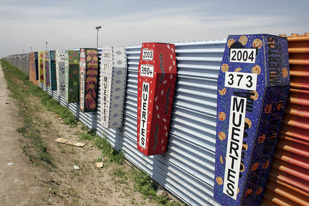 Memorial coffins on the US-Mexico barrier for those killed crossing the border fence in Tijuana, México