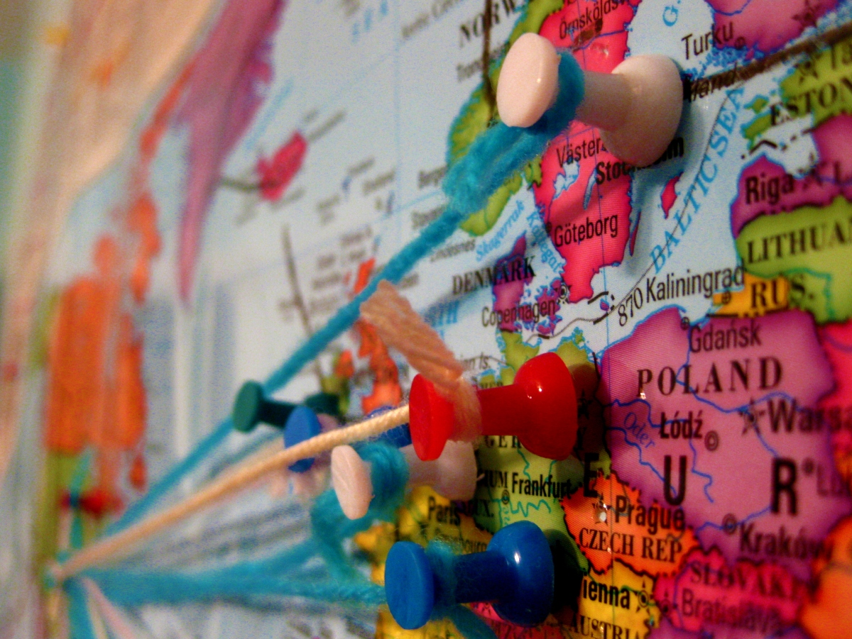 colorful map of eastern europe with pushpins connected by pieces of yarn
