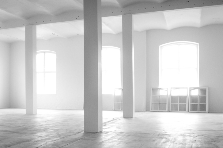 the inside of an empty factory building, all painted in shades of white
