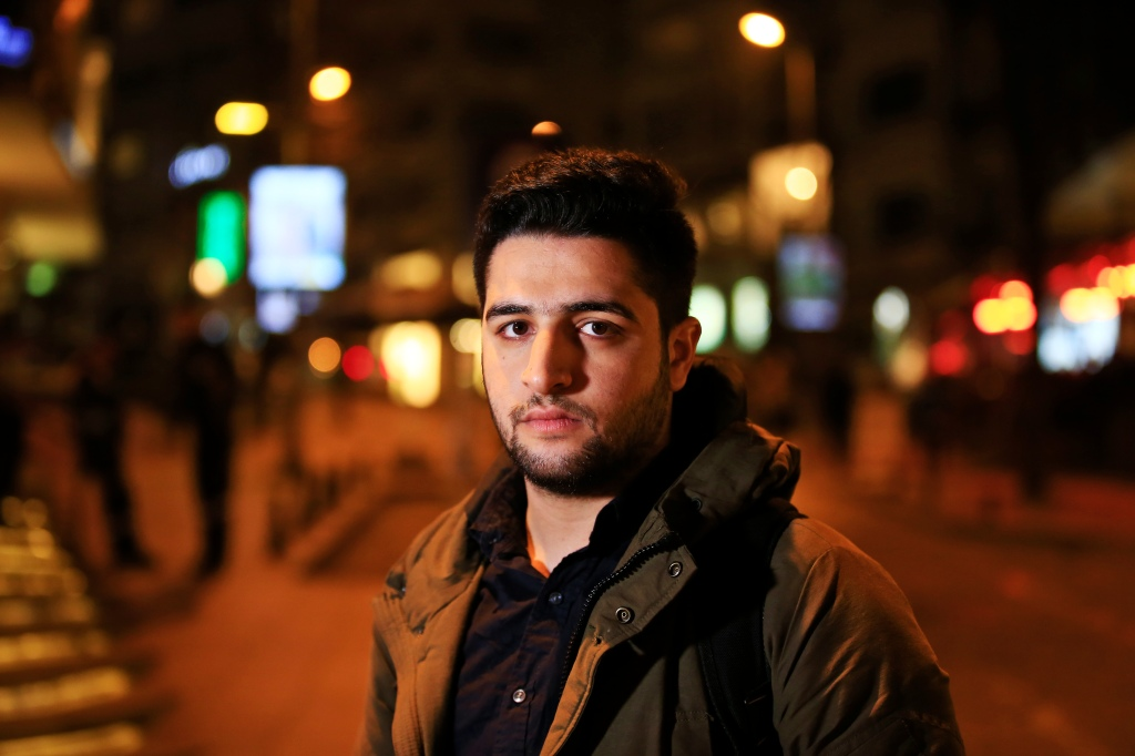 "Syrian cinematographer Khaled Khateeb, a member of the Syrian Civil Defense, who provided video for the Oscar-winning documentary ""The White Helmets"", in Istanbul, Monday, Feb. 27, 2017. The young volunteer in the Syrian search-and-rescue group featured in an Academy Award-winning documentary said Monday he hopes the award will help stop ""massacres"" in his country, and described a U.S. decision to block him from traveling to Los Angeles for the Oscars as ""America's loss."" (AP Photo/Lefteris Pitarakis)"
