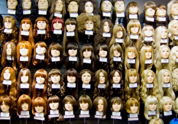 a collection of wigs, in different lengths, styles, and h