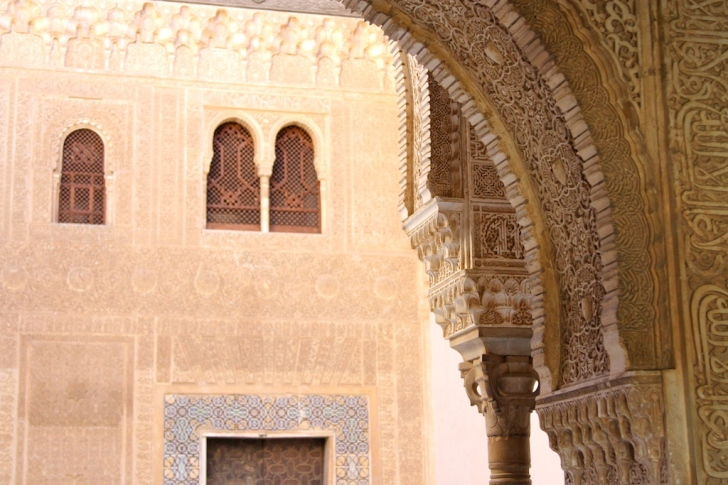 detailed carvings on an archway at the alhambra in granada, spain
