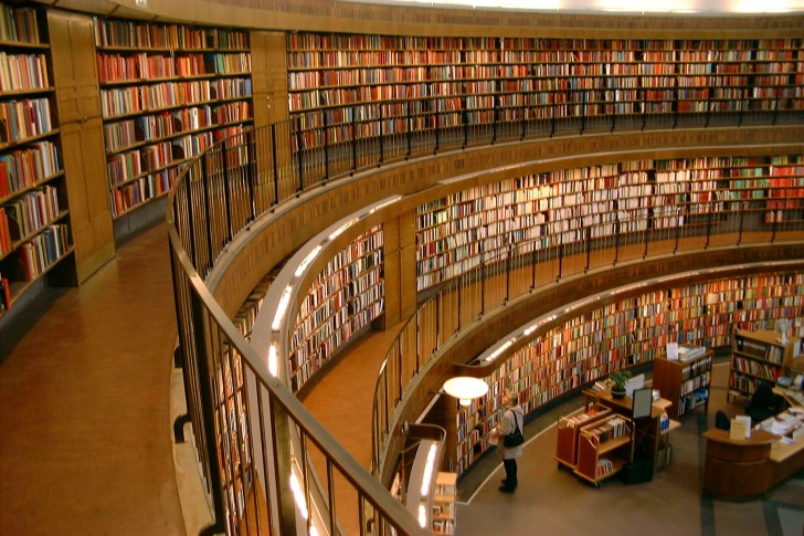 Rows of books line the walls of the public library in Stockholm, Sweden