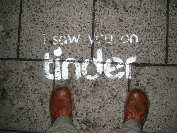 "Graffiti on the sidewalk reading ""i saw you on tinder"""