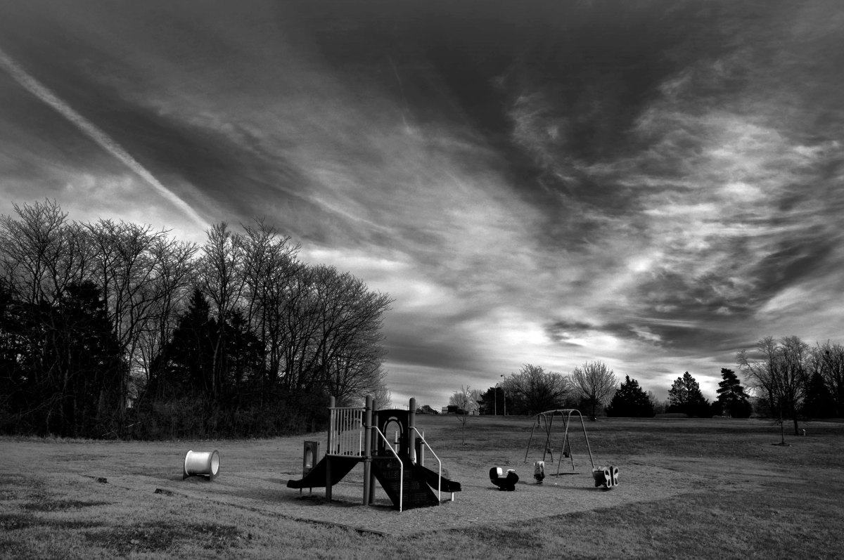 an empty playground, in black and white