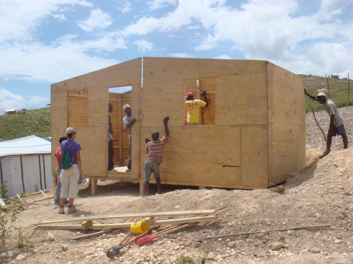 Volunteers build a house in Canaan, Haiti
