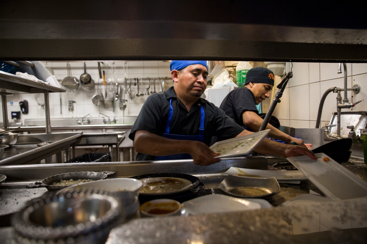 Young woman washing dishes in kitchen by andersen ross photography for - Dishwashers Esteban Soc Left And Joselino Aguilar Right At Work In The Kitchen Of Mexican Restaurant Caracol Photo By Scott Dalton For The Washington