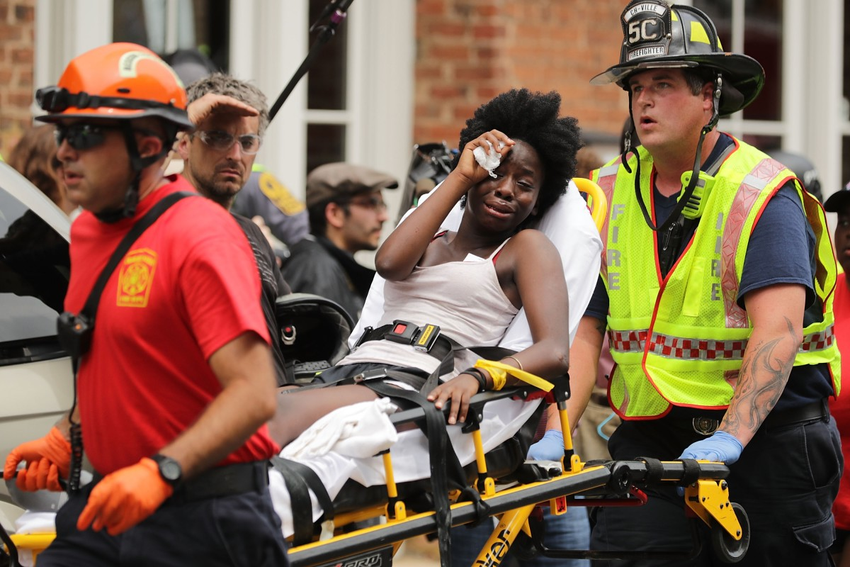 Rescue workers aiding victims of the car attack in Charlottesville.