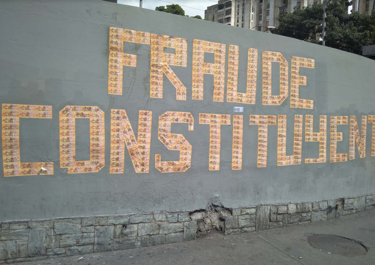 "activists plastered ""fraude constituyente"" with bolivar bills"