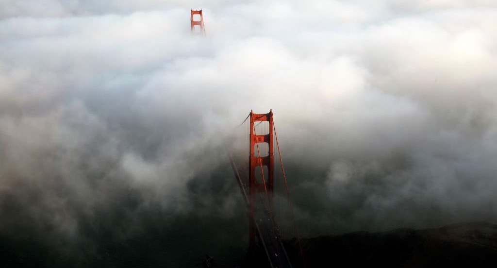 Aerial view of the Golden Gate Bridge in dark fog