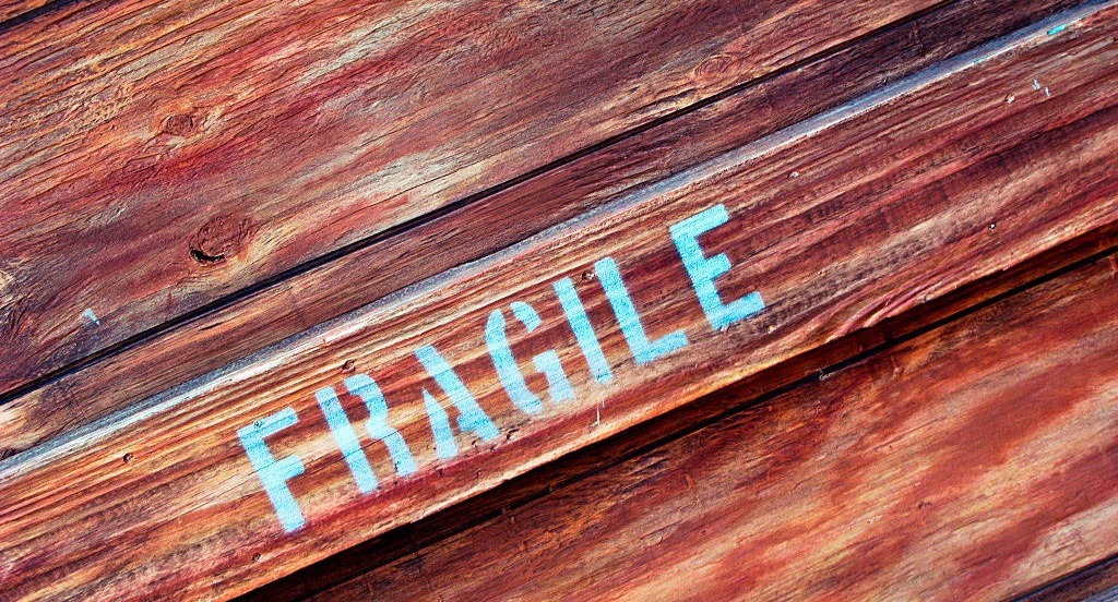 """Fragile"" stenciled onto wooden box"