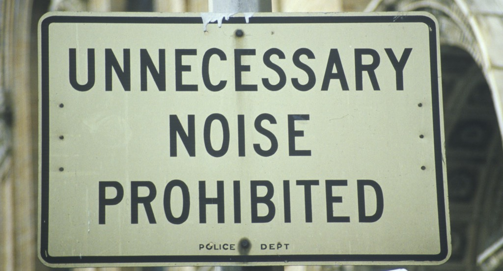 "A sign that reads ""Unnecessary Noise Prohibited'"