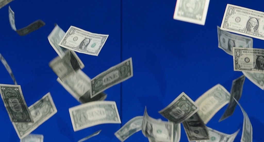 Raining money on blue background