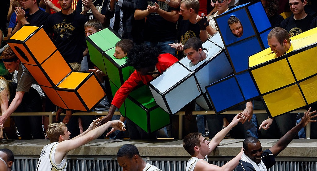 Students dressed as the video game Tetris, shaking hands cooperatively
