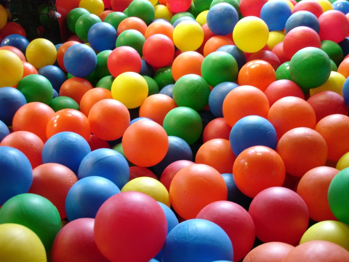 a close-up image of red, orange, blue, green, and yellow balls