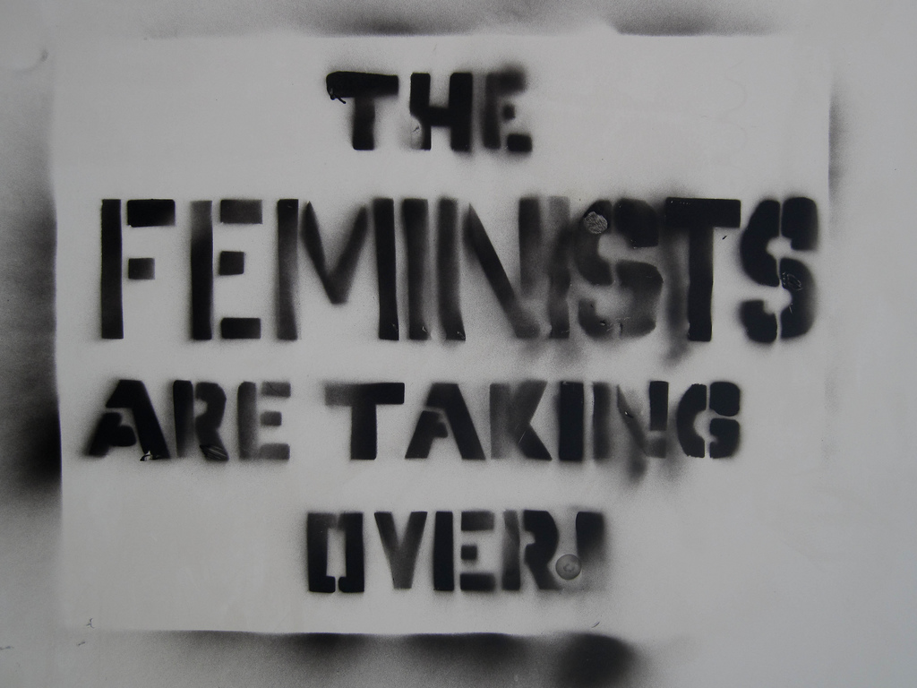 "graffiti reading ""the feminists are taking over!"""