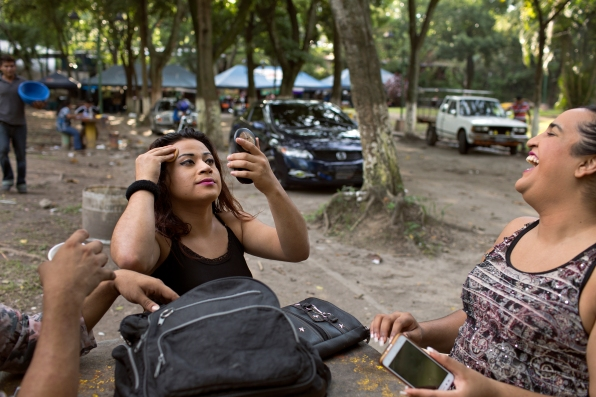 Nicole retouches her makeup while out at the park with Sadira, Amy and Karla.