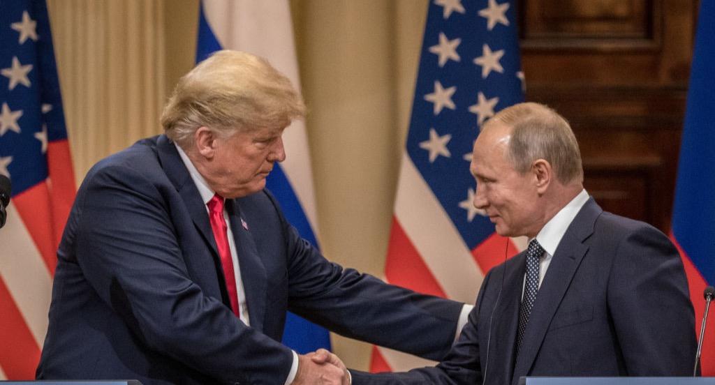 Trump shakes Putin's hand
