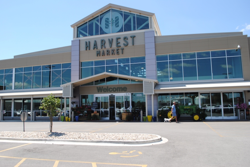 Champaign, IL's Harvest Market is styled like Whole Foods for the Heartland—complete with a John Deere tractor stationed outside. (Photo courtesy of the author.)