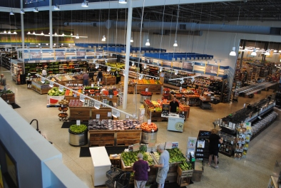 Interior of Harvest Market from the upper mezzanine, where shoppers gather for lunch and board games during the day and glasses of wine at night. (Photo courtesy of the author.)