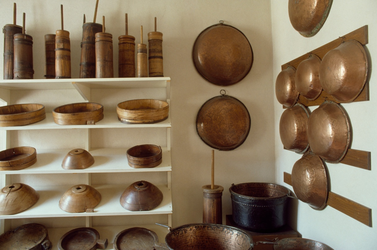 Copper and wooden pots and kitchen utensils