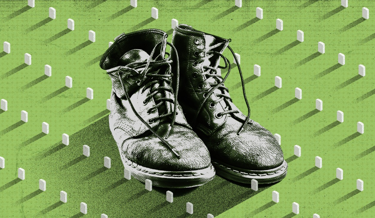 military boots against the background of small identical tombstones