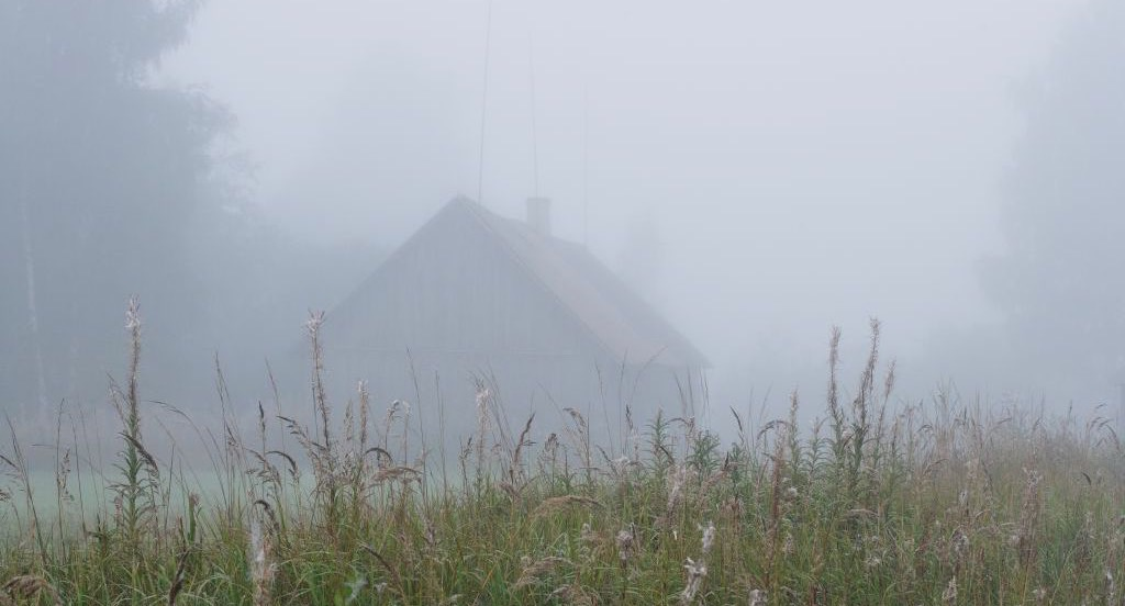House obscured by fog
